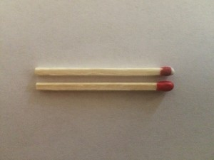 A safety match and a strike anywhere match side by side