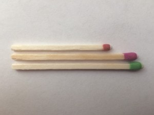A match from each of three different brands I tested placed side by side to compare length and thickness