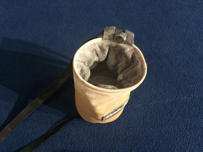 A basic chalk bag with climbing chalk inside