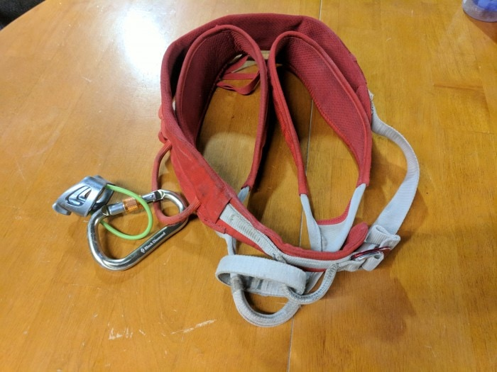 Climbing harness and belay device