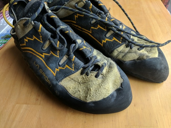 A pair of Katana Lace climbing shoes that has been resoled four times