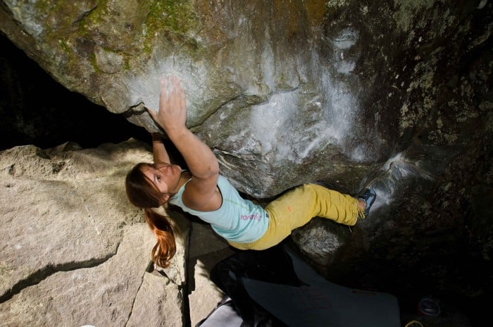 A girl bouldering
