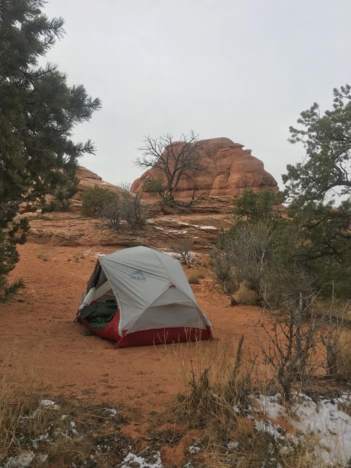 Camping in the Hubba Huuba on a snowy winter morning in Moab, Utah