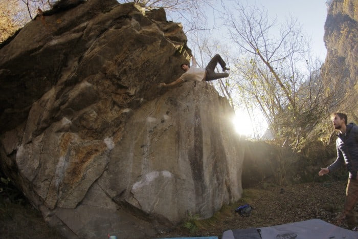 A powerful bouldering move
