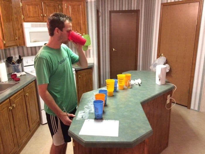 A taste tester samples reconstituted powdered milk.