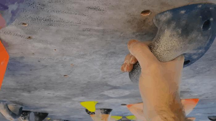 A climber holding a jug