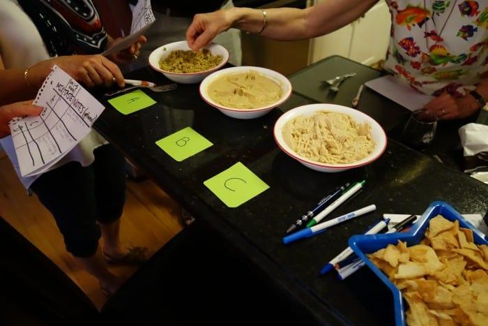 Testers tasting the various powdered hummus mixes