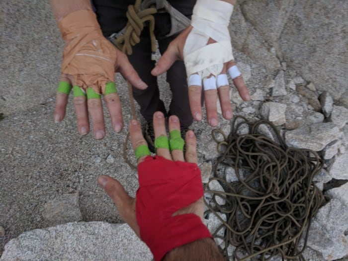 Taped up hands sporting the different brands of climbing tape we tested