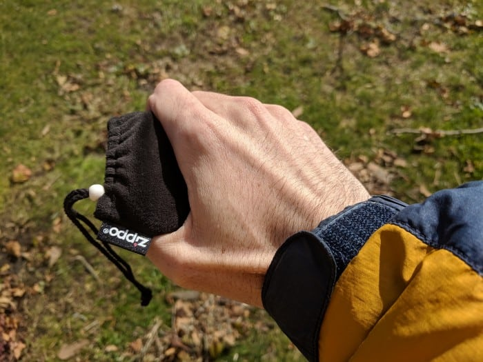 Holding the Zippo 12-Hour Hand Warmer in its fabric pouch