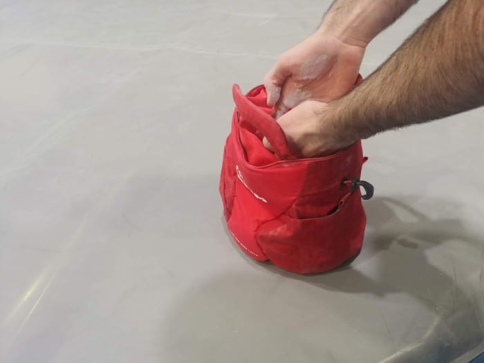 Using the DMM Edge to chalk up at the bouldering pads.