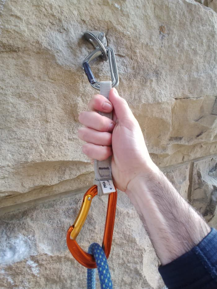 Pulling on the wide dogbone of the Petzl Spirit Express.
