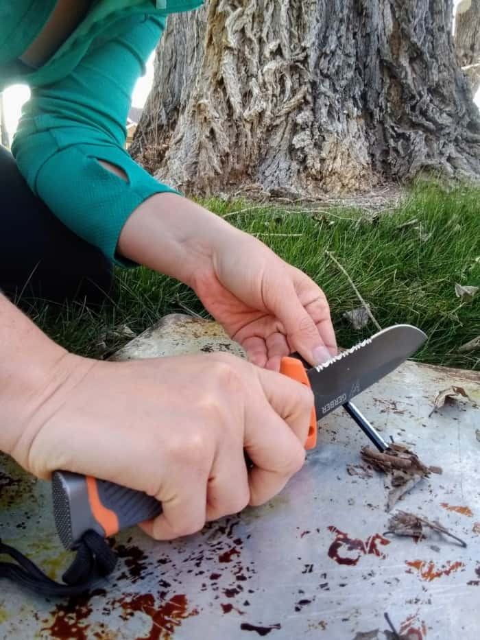 Lighting tinder with the Gerber Bear Grylls Ultimate Fixed Blade Knife.