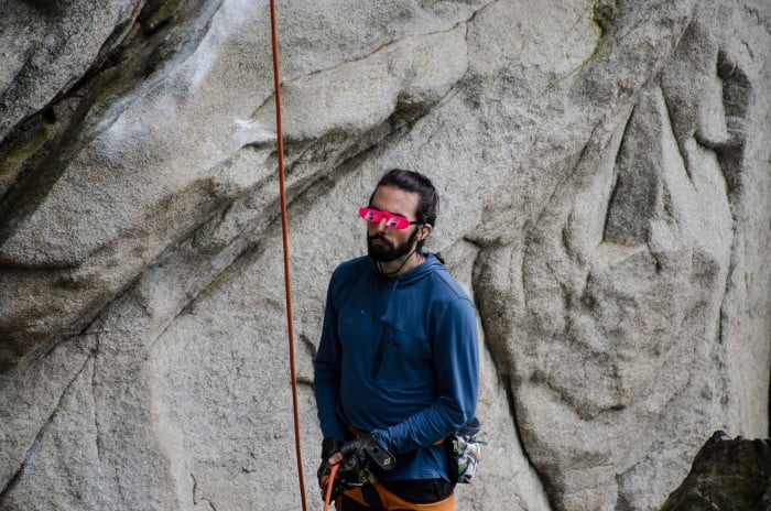 Belaying in a pair of belay glasses.