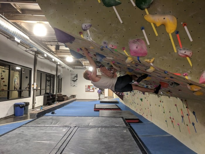 Bouldering indoors over thick mats.