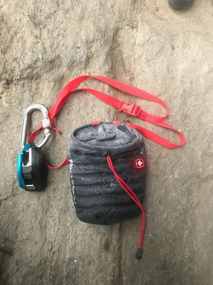 The Black Diamond Hot Forge bag next to a Petzl GriGri.