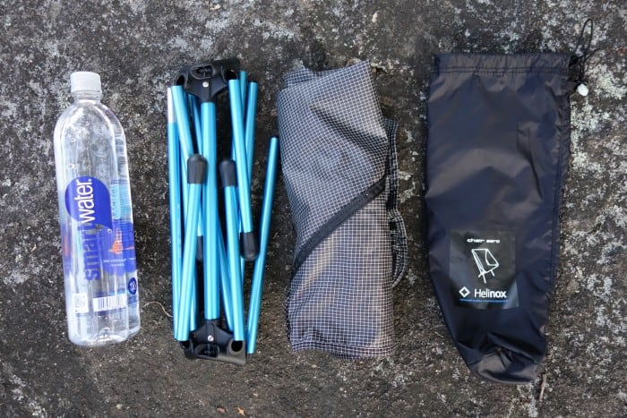 The components of the Helinox Chair Zero next to a water bottle.