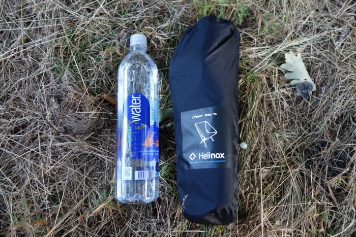 The Helinox Chair Zero packed next to a smartwater bottle.