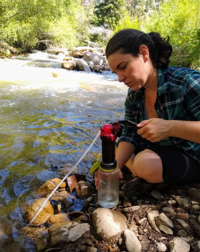 Filtering water from a stream with the MSR MiniWorks EX Microfilter.